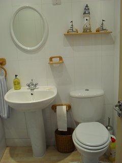 Topl floor bathroom. Bath, with shower over, w.c. and sink.