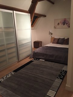 Bedroom 2 is beautiful, down the hallway from Bedroom 1