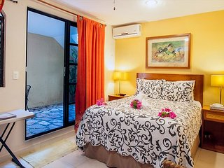 Economical hotel style room with queen bed & bath w shower