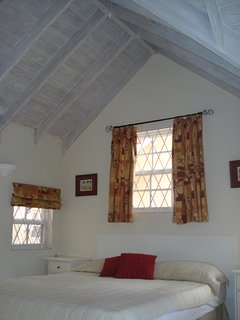 Bedroom with double bed and mosquito net