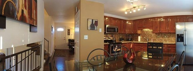 Beautiful upgraded Kitchen with granite counter tops, wood floors table seats 6