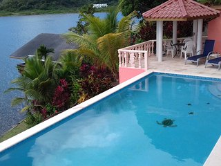 WATERFRONT WITH POOL,  KAYAK, SNORKEL, DIVE. 2 BEDROOM, 2 BATH WITH AC