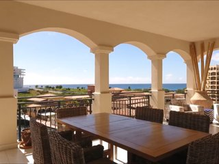 Porto Cupecoy Penthouse pool hotub outside fireplace ocean & lagoon Views 4 bdrm