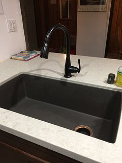 large kitchen sink and island