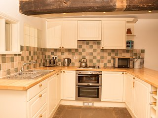 fully fitted kitchen with electric oven and fridge; washing machine & dish washer  in utility room