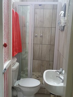 Stand alone Shower and toilet in The Village House