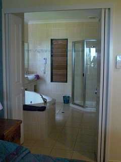 Two way bathroom from ensuite and living area with separate toilet