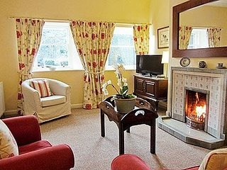 Snug south facing sunny sitting room with TV, Freeview, DVDs/player, dock, coal fire, lots of games.