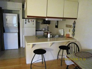 Kitchen has stove, microwave,washer/dryer and all the utensils you might need
