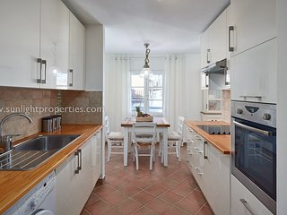 Fully appointed kitchen with dining area.