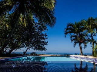 The Beach House,3 suites beachfront villa touching paradise