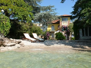 Lake side charming villa with its very own private beach and enclosed garden