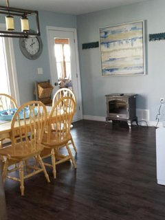 dining area off the kitchen with access to the sunroom with a second fridge for drinks!