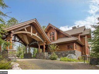 Eagle Point: Elite Wilderness Log Home with Welcoming Porte Cochere and Grand