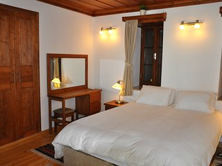 Double room with hand crafted furniture and ceiling