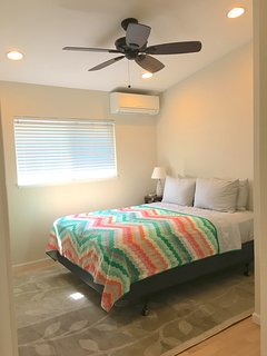Guest bedroom- 1 queen size bed, AC, closet, vaulted cielings, recess lights, and ceiling fan