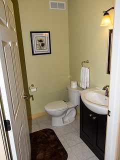 Just past the mudroom is the half bath!