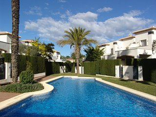 Luxury 2 bed terraced house just 600 meters from beautiful sandy beach.