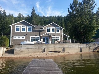 Serene lakefront home with 80 ft frontage and private wharf.and boat moorage.