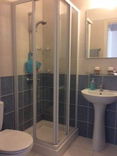 2nd En-suite bathroom, with toilet, basin and shower cubicle