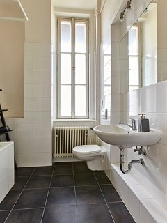 1 full bath with bath/ shower combination sink and toilet