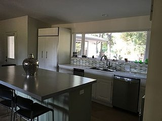 Dishwasher, ice maker, large picture windows throughout
