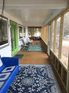 600 sq ft screened-in, wrap-around front porch