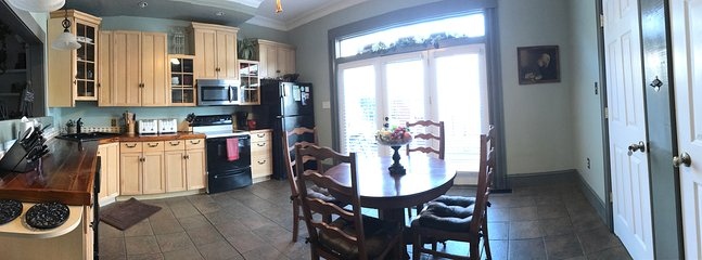 pano view of kitchen and exit onto rear veranda plus antique oak dinette seats another 4 - 6