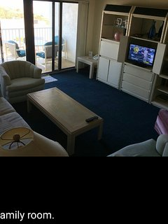 The living room with everyone's favorite balcony.  Watch the cruise ships sail in and out!