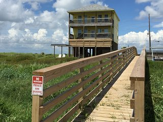 New private dune walkover built in 2016, takes you from my front yard directly onto the beach.