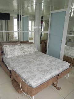 Sofa/sofa bed night time. Large queen size bed (1m40/2m) with real mattress.