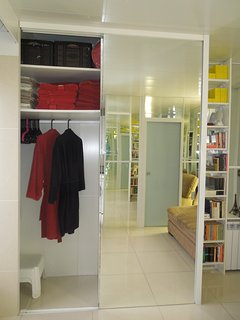 Large mirrored wardrobe (1)with lots of storage room, 2 bathrobes, ironing board...
