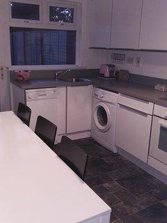 Kitchen with dishwasher, microwave, fridge freezer. Fully equipped.