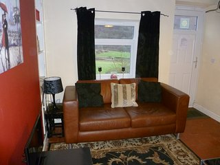 Two seater leather settee and views across the valley
