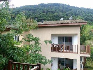 Casa em condomínio de charme perto da praia em Juqueí, Barra do Una
