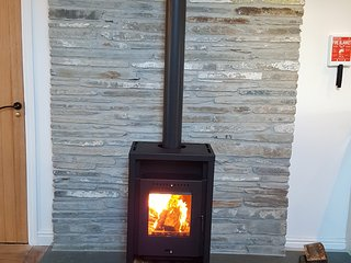 5 kw Log burner on natural slate fireplace is included.  The property is fitted with a fireguard.