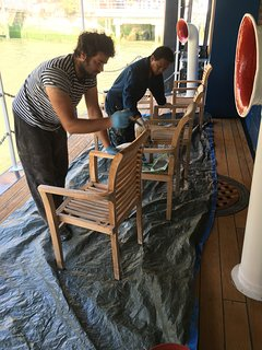 Giancarlo and Sherman, our brilliant maintenance team, re-sealing the teak external dining furniture