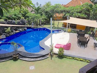 View of turtle shaped pool & shaded deck  from Villa 4 balcony