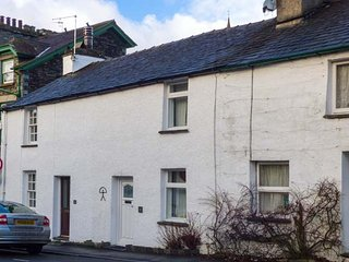 ANNIVERSARY COTTAGE, mid-terrace, grade II listed, WiFi, in Ambleside, Ref