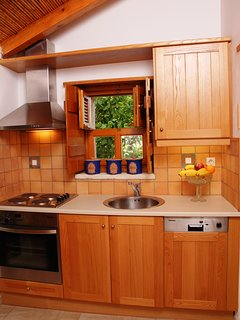 This is the second kitchen (upper level), with a bigger refrigirator than the others two.
