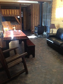 Wood stove , couch, living room with flat screen TV. 4 Queen bunk beds.