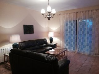 Los Pinos lounge has leather suite & patio doors