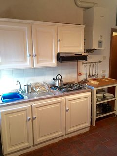 Gas stove top and fully stocked kitchen