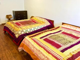 Bedroom 1. There are 2 x queen-sized beds. Sleeps 4. Room is air-conditioned & has a ceiling fan too