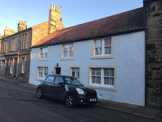 Charming cottage is in the heart of Crail with a large private garden