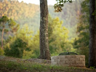Fire pit with mountain view at Storybrook cottage rental in arkansas.