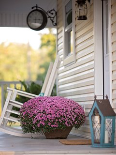 Wrap around porch on the farmhouse cottage rental.