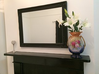 Bedroom mirror and fireplace