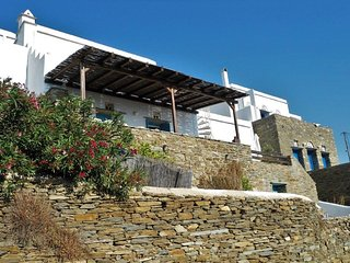 Our house with the pergola and the stairs leading to the roof terrace.