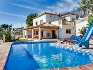 Luxurious villa w/ stunning ocean views, private pool, terrace, & fireplace!